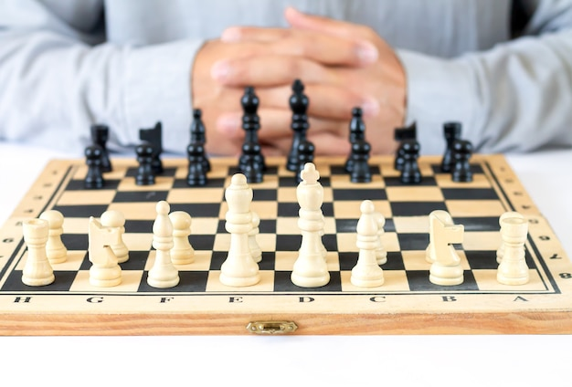 Man playing chess game business strategy concept