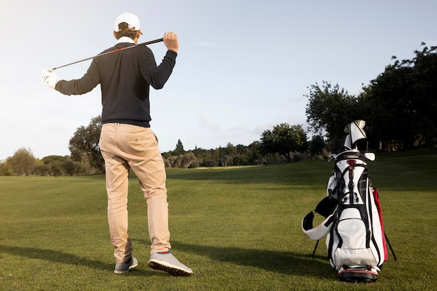 Man playing golf on the field