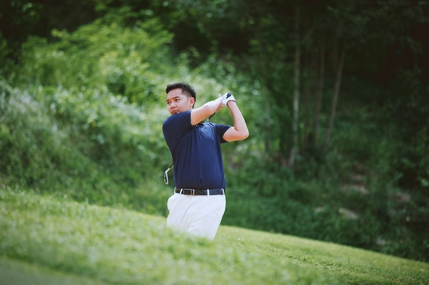 Man playing golf on a golf course