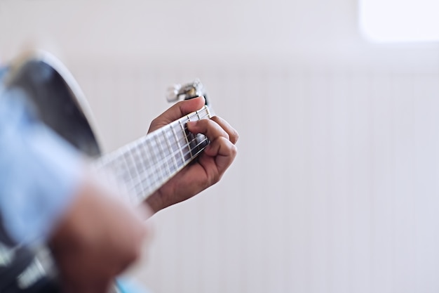 Man playing guitar. practicing in playing guitar