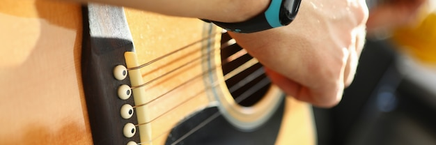 Man playing on guitar