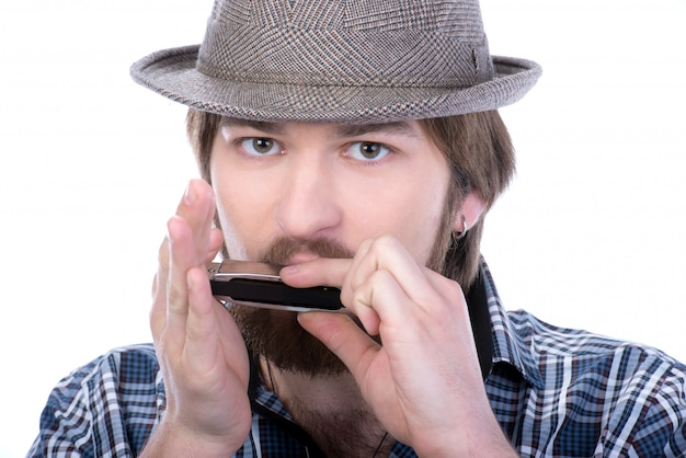 Man playing the harmonica
