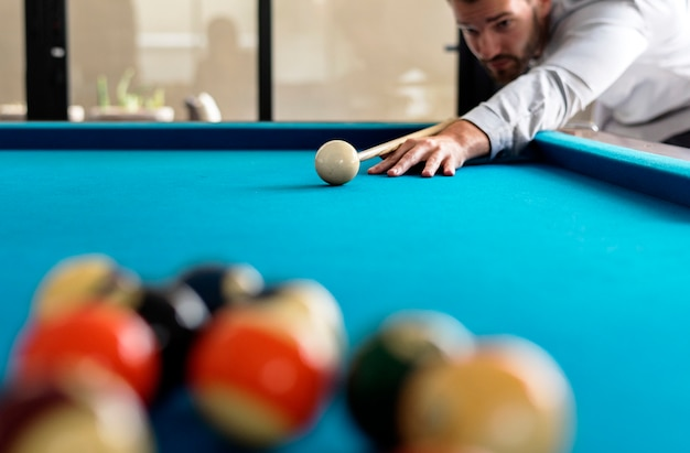 Man playing pool by himself