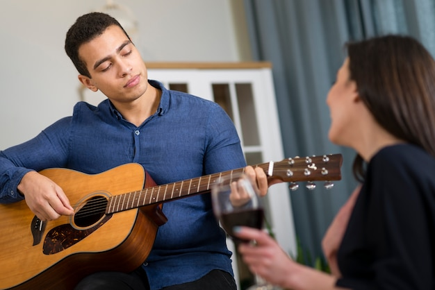 Man playing a song for his girlfriend