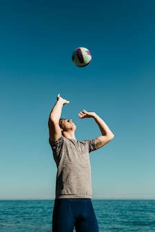 Man playing volleyball at the beach