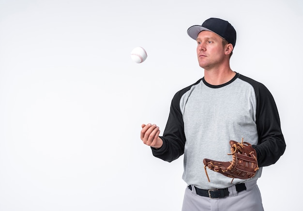 Man playing with baseball and holding glove