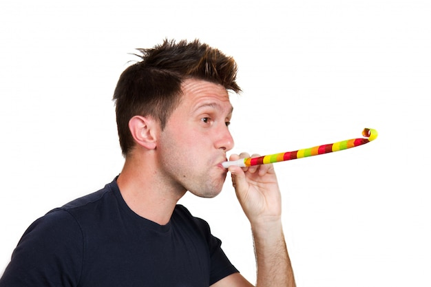 Man playing with party blowers