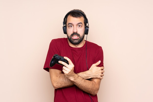 Man playing with a video game controller freezing