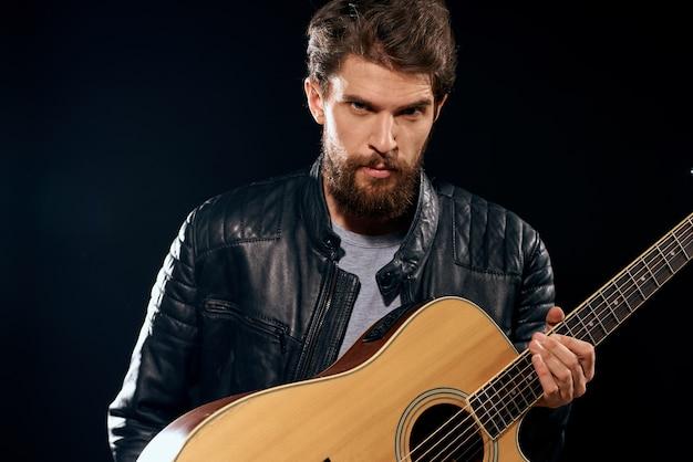 A man plays the guitar