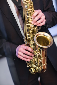 A man plays the saxophone