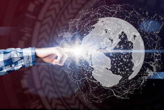 Man point at 3d earth globe hologram