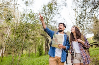 Man pointing at distance for woman