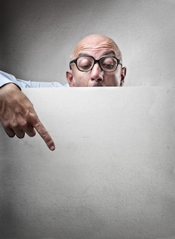 Man pointing on a board