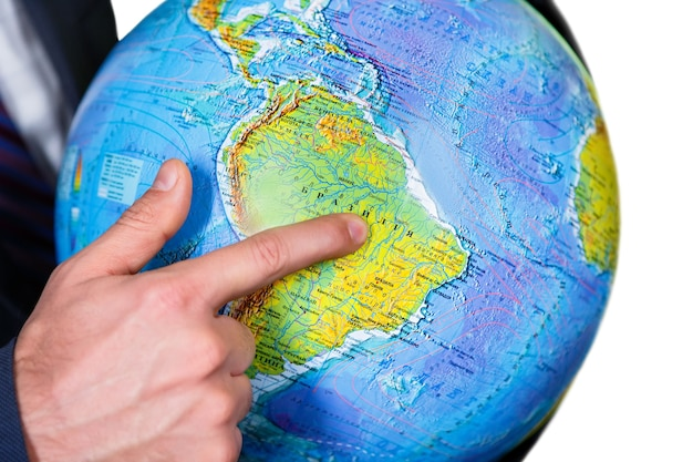 Man pointing at the continent. far-far away. welcome to south america. a continent amidst the ocean.