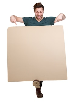 Man pointing fingers down to blank poster