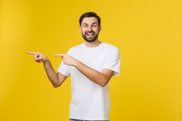 Man pointing showing copy space isolated. casual handsome caucasian young man.
