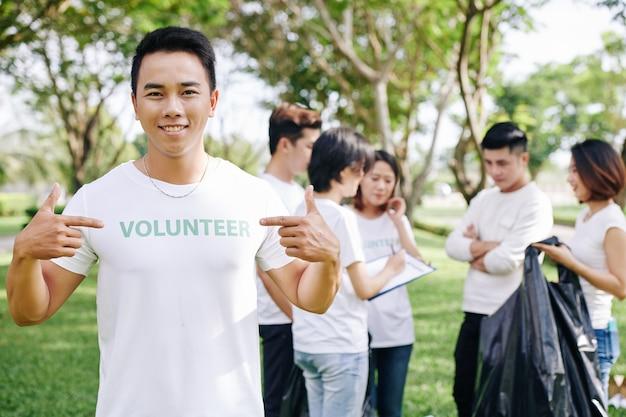 Man pointing at volunteer inscription