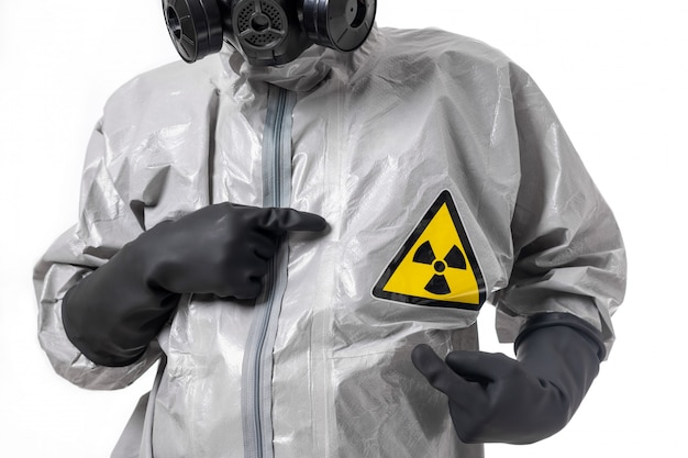A man poses in a gray protective suit