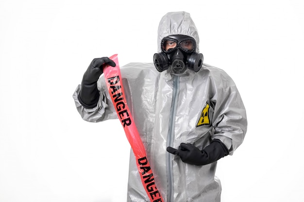 A man poses in a protective suit