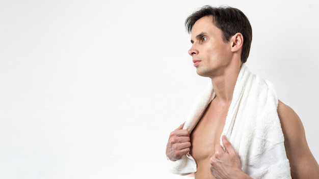 Man posing after bath with copy space