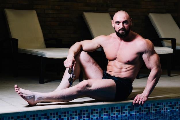 Man posing near swimming pool