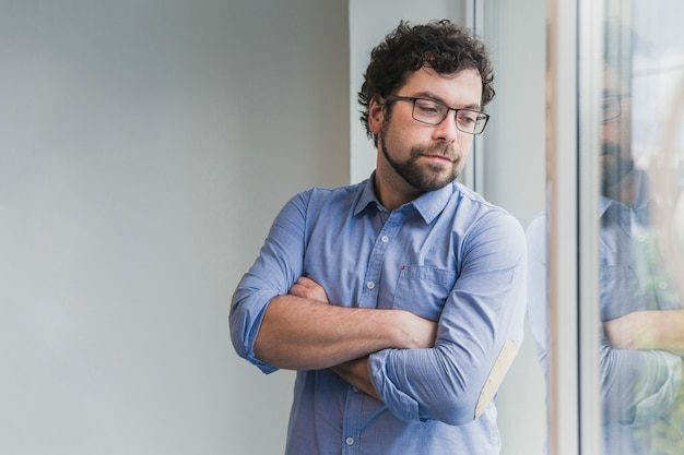 Man posing near window in office
