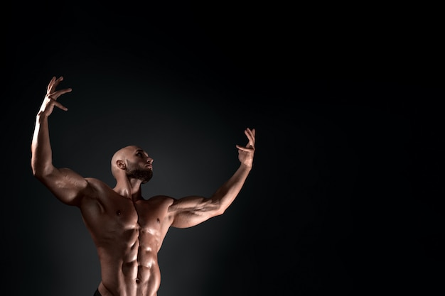 Man posing in the studio on a dark background