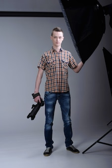 Man posing with camera in his hands