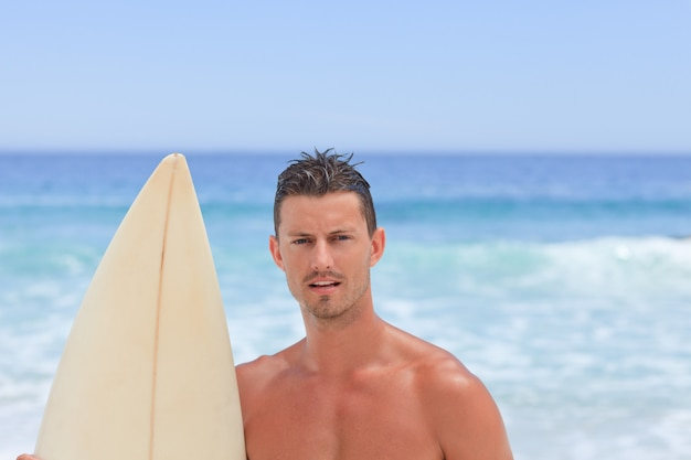 Man posing with his surfboard