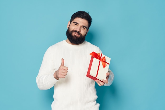 Man posing with a present