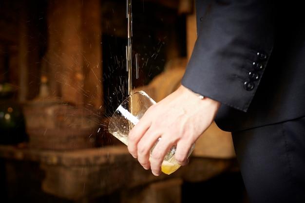 Man pouring apple cider in asturias