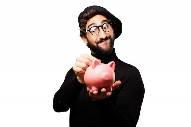 Man pouring a coin into a piggy bank