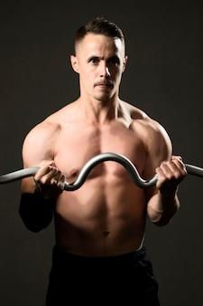 Man powerlifting at gym