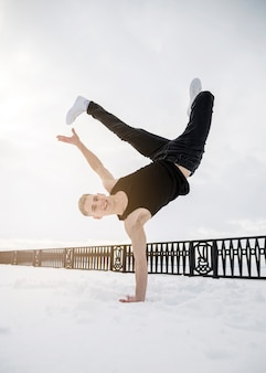 Man practicing hip hop outside in the snow