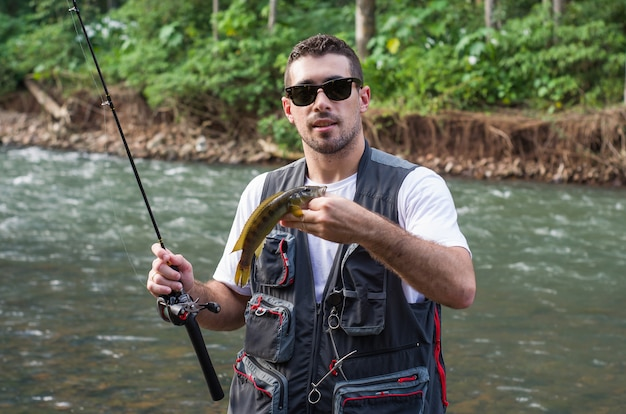 Man practicing sport fishing in river