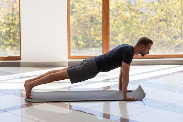 Man practicing yoga inside