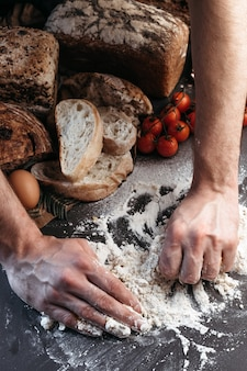 Man prepares dough for bread, gluten-free and without animal products. bread, gluten-free and without animal products.