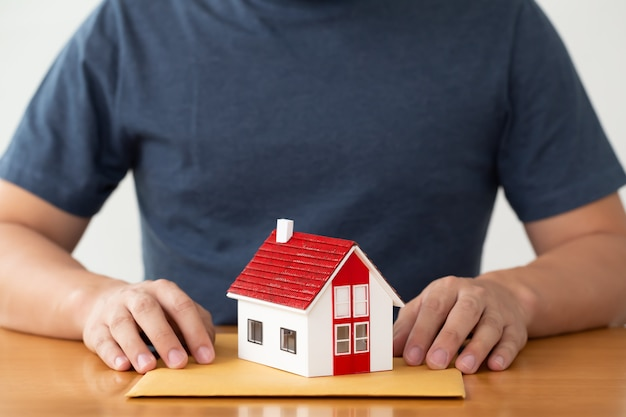 Man preparing documents file for loan home and refinance