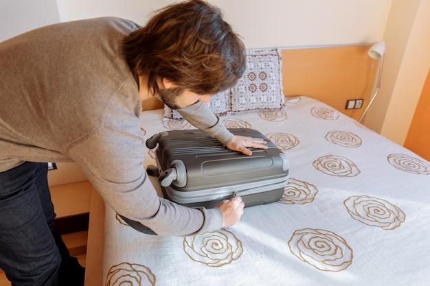 Man preparing the suitcase