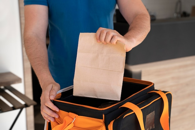 Man preparing takeaway food for delivery Free Photo