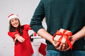 Man presenting gift for woman