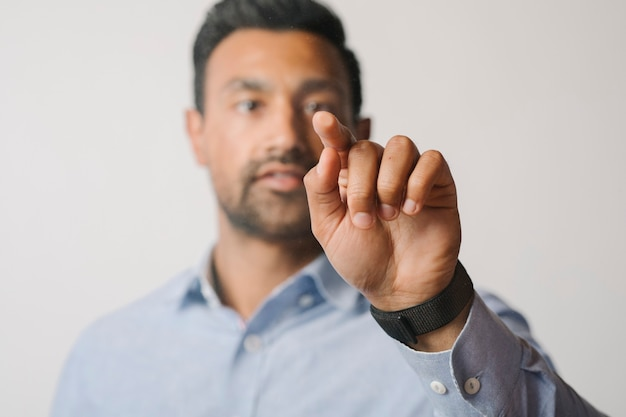 Man pressing his finger to a screen