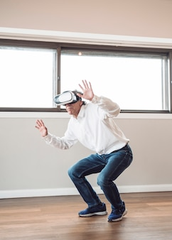 Man pretending to touch while wearing virtual reality headset