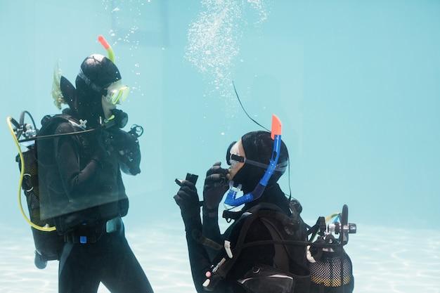 Man proposing marriage in scuba gear