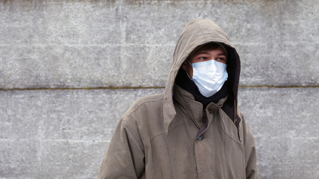 Man in protective face mask respirator. outbreak of viral disease coronavirus covid-2019.