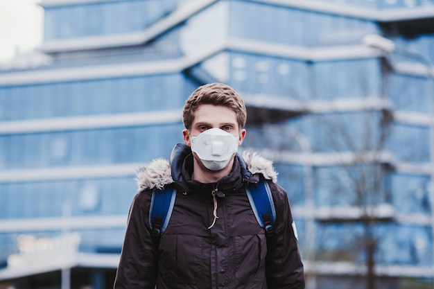 Man in protective mask against transmissible infectious diseases