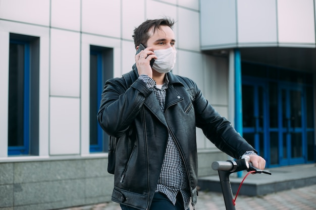 Man in protective mask talking by phone