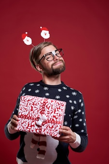 Man proud of his christmas present isolated