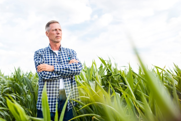 Man proudly posing for the camera on a field