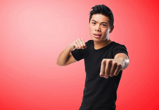 Man punching on a red background